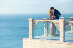 Couple posing on a balcony Royalty Free Stock Photography