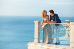 Couple posing on a balcony Royalty Free Stock Images
