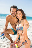 Couple posing at the beach Stock Image