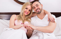 Couple posing in bed Stock Photos