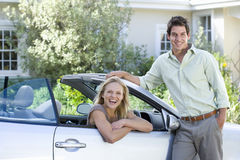 Couple posing by car stock images