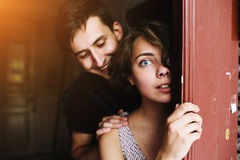 Couple posing in the doorway Royalty Free Stock Photos
