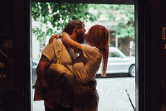 Couple posing in the doorway Stock Images