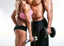 Couple posing with dumbbells Stock Photo