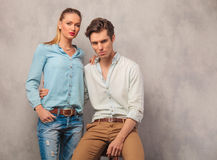 Couple posing him seated holding her while she stands Stock Images