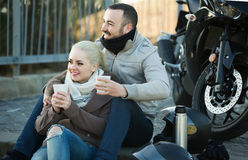 Couple posing near motor bike with sandwitches and coffee Royalty Free Stock Photography