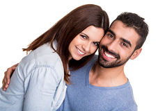 Couple posing over white background Stock Images