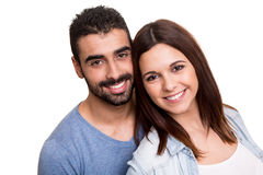 Couple posing over white background Stock Photos