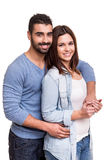 Couple posing over white background Stock Image
