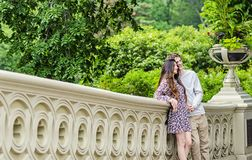 Couple posing for photo in Central Park New York City. Couple posing for photo on Bow Bridge in Central park in New York City royalty free stock photo