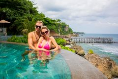 Couple posing for photo on exotic tropical vacation stock photo
