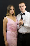 Couple posing in secret agent style Stock Photography