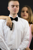 Couple posing in secret agent style Royalty Free Stock Photo