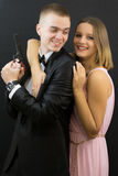 Couple posing in secret agent style Royalty Free Stock Photos