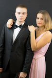 Couple posing in secret agent style Royalty Free Stock Image