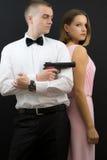 Couple posing in secret agent style Stock Photos