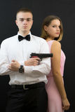 Couple posing in secret agent style Royalty Free Stock Images