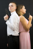 Couple posing in secret agent style Stock Image