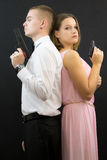 Couple posing in secret agent style Stock Images