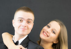 Couple posing in secret agent style Royalty Free Stock Photography