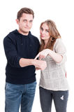 Couple posing and showing wrist watch Royalty Free Stock Images
