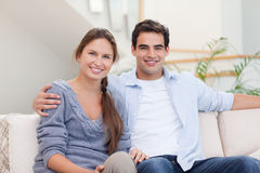 Couple posing in their living room Stock Photos