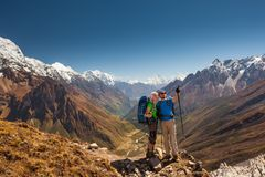 Couple is posing to the camera in front of Manaslu valley in hig Royalty Free Stock Photos