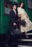 Couple posing on vintage train car Stock Image