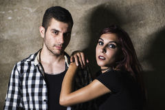 Couple posing on wall with night Royalty Free Stock Photo
