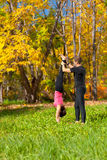 Couple practice yoga in forest Stock Photos