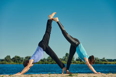 Couple practicing acroyoga Royalty Free Stock Images