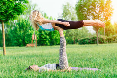 Couple practicing acroyoga Stock Photo