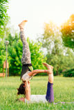 Couple practicing acroyoga Stock Images