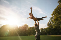 Couple practicing acroyoga at park Royalty Free Stock Image