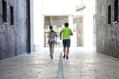 Couple practicing jogging in the city Royalty Free Stock Photos