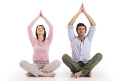 Couple practicing yoga Stock Photos