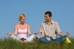 Couple practicing yoga Stock Image