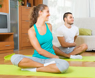 Couple practicing yoga at home Royalty Free Stock Photography