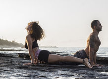 Couple practicing yoga Stock Images