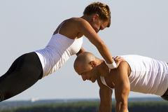 Couple practising on the early morning sun Royalty Free Stock Images