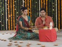 Couple praying on Diwali Royalty Free Stock Images