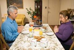 Couple Praying - horizontal Royalty Free Stock Image
