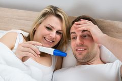 Couple with pregnancy test Stock Photo