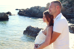 Couple with pregnant woman relaxing Stock Images
