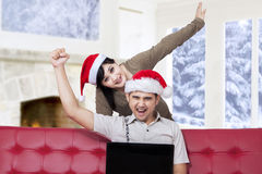 Couple prepare christmas by shopping online Stock Photo