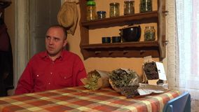 Couple prepare dried linden blossom tea in rural kitchen. 4K stock video footage