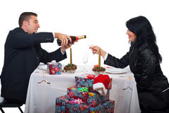 Couple prepare for toast and celebrate Xmas night Stock Photo