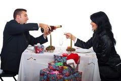 Couple prepare for toast and celebrate Xmas night stock photo