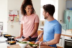 Free Couple Preparing Batch Of Healthy Meals At Home In Kitchen Together Stock Photo - 157271110
