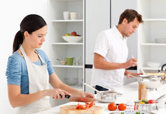 Couple preparing bolognese sauce and pasta Royalty Free Stock Photo